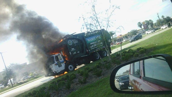 A garbage truck fire on Colonial Boulevard has closed the roadway.