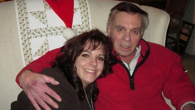 Candace Baer-Delis with her father, Thomas Baer, at Christmas in 2013.