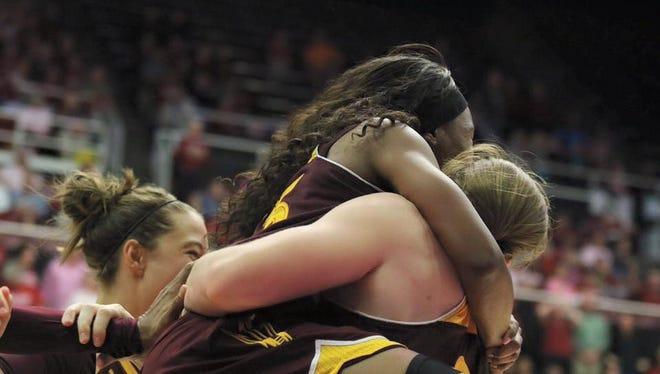 ASU's Elisha Davis hugs Sophie Brunner after Brunner's second game-winning play in the last three games Sunday at Stanford.