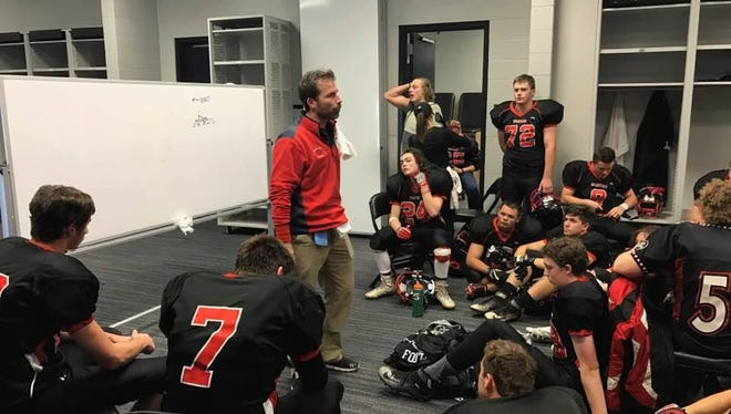 Rocori head coach Mike Rowe talks to his team at halftime Friday at U.S. Bank Stadium. The Spartans trailed Winona 20-16 and wound up losing, 34-30.