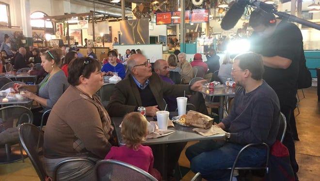 NBC News correspondent Harry Smith (center) interviews a family at Central Market in downtown York for an NBC Nightly News segment on Trump voters who helped swing the election in Donald Trump's favor. The segment aired on Thanksgiving.