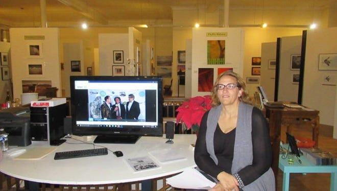 Artist Cynthia Johnson takes a breather at her reception.
