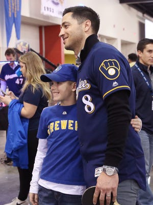 Jacksen Gomolla, 8, poses with Ryan Braun on Sunday at the Brewers' On Deck fan festival after playing a game of table tennis with him at the Wisconsin Center.
