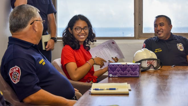 Imani Malanche, wearing a red shirt, Guam Fire Department chief of the day, sits in on a departmental breifing at the GFD offices in Hagåtña on Wednesday, July 18, 2018. Malanche, a Make-A-Wish recipient from Arizona, is visiting Guam along with other family members, in fulfillment of her wish to see the island and the chance to meet her mother's family. Malanche has been diagnosed with a rare blood disorder.