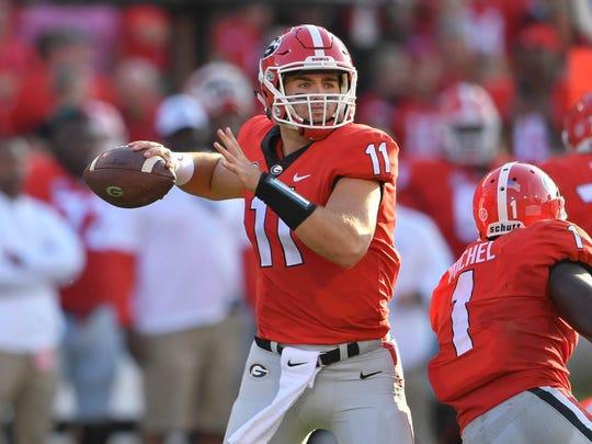 Georgia quarterback Jake Fromm looks to throw a pass