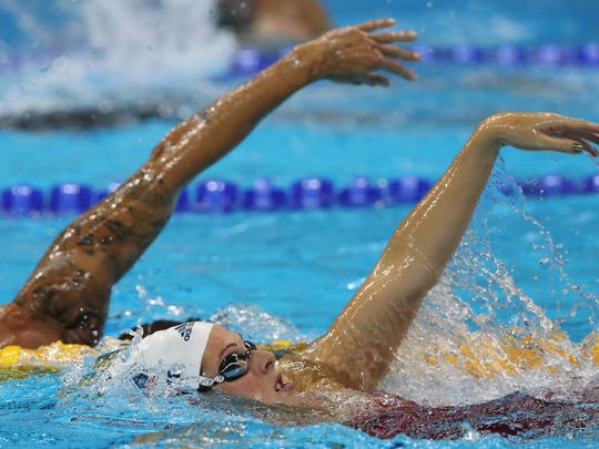 """After undergoing therapy, Schmitt is swimming in her third Olympics. """"It's OK to ask for help,"""" she said. """"That shows more strength than trying to persevere and push through it."""""""