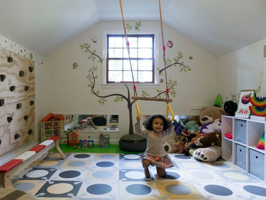 "Allison and Pee Jay Alexander created India's playroom, which she calls her ""playground."" Among other things, the space includes a swing, climbing wall, and balance beam."