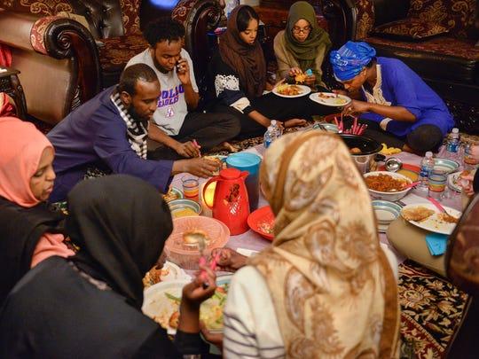 Katra Hethar, far left, and her family gather on the