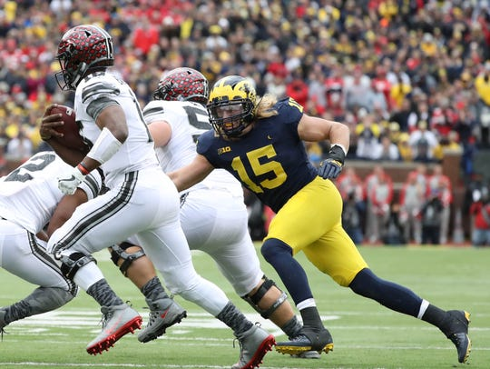 Michigan's Chase Winovich pursues Ohio State's J.T.