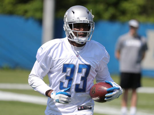 Lions running back Kerryon Johnson goes through drills during OTAs on Thursday, May 24, 2018, at the Allen Park practice facility.