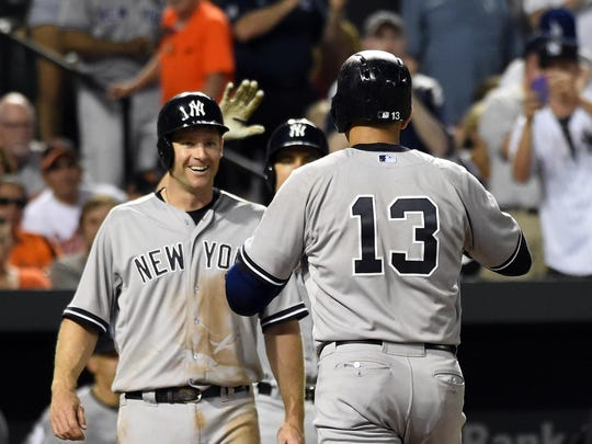 New York Yankees designated hitter Alex Rodriguez (13) celebrates with teammates after hitting a two-run home run.