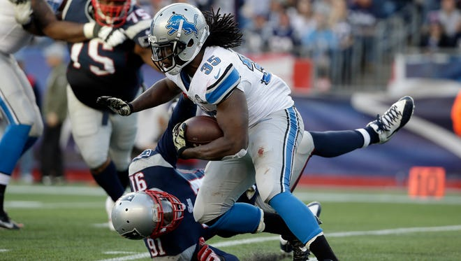 Detroit Lions running back Joique Bell (35) runs past New England Patriots linebacker Jamie Collins (91) in the second half Sunday, Nov. 23, 2014, in Foxborough, Mass.