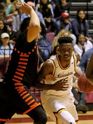 Midwestern State's Ola Ayodele drives to the basket