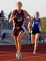 Bowie's Kamryn Cantwell crosses the finish line in