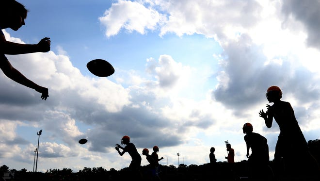 Pittsville High School football players practice drills on the first day of official practice for the season, August 2, 2016.
