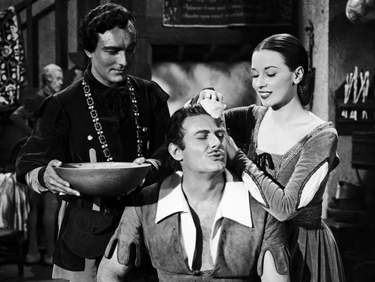 Patricia Morison with Jon Hall (center) as Robin Hood