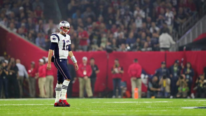 HOUSTON, TX - FEBRUARY 05:  Tom Brady #12 of the New England Patriots walks on the field in the third quarter during Super Bowl 51 at NRG Stadium on February 5, 2017 in Houston, Texas.  (Photo by Tom Pennington/Getty Images) ORG XMIT: 694911629 ORIG FILE ID: 633952166