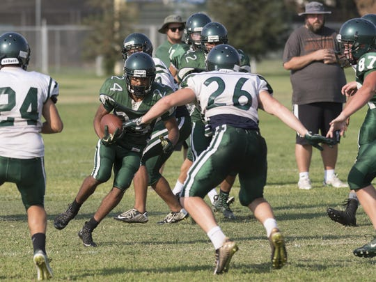 El Diamante linebacker Alec Pierce (26) defends against a Miners ballcarrier during football practice on Tuesday, August 23, 2016. Ron Holman