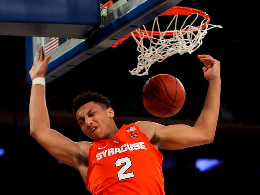 Syracuse forward Matthew Moyer dunks against Connecticut during the second half of an NCAA college basketball game Tuesday, Dec. 5, 2017, in New York. Syracuse won 72-63. (AP Photo/Julie Jacobson)