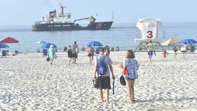 Beachgoers head to Breakfast With the Blues on Wednesday morning at Pensacola Beach.