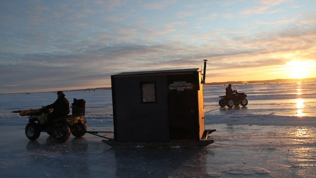 Sturgeon spearers use ATVs to position spearing shacks on Lake Winnebago on opening morning of the 2012 sturgeon spearing season. Photo taken Feb. 11, 2012 by Paul A. Smith.