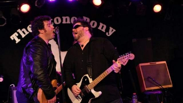 Sean and Ryan Loughlin of The E Street Shuffle share a mic at The Stone Pony