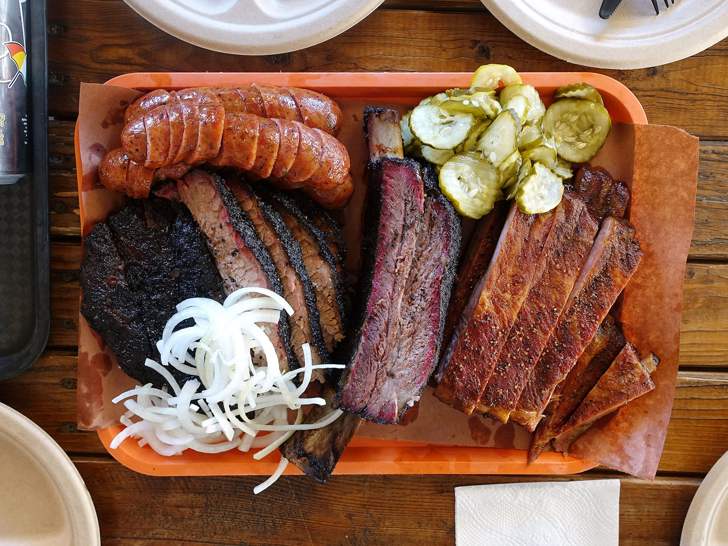 A selection of barbecue (from top left: sausage, fatty