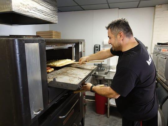 Adrian Langu, chef and owner at Crisp Premium Pizza,