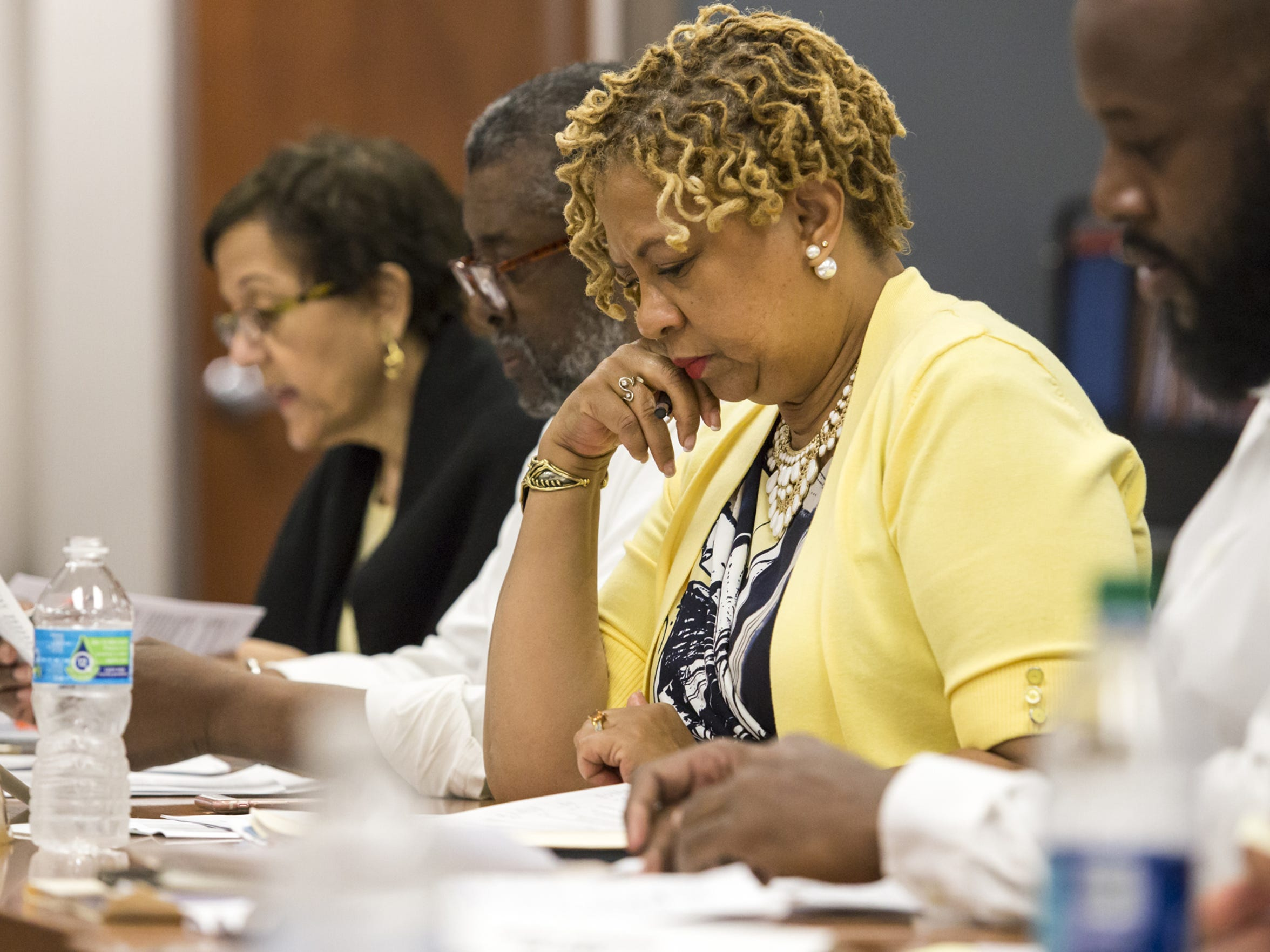 Wilmington City Council President Hanifa Shabazz looks over a report during a meeting with city officials and community leaders on recommendations from a Centers for Disease Control and Prevention report on violence in the city at the Achievement Center in Wilmington earlier in 2016.