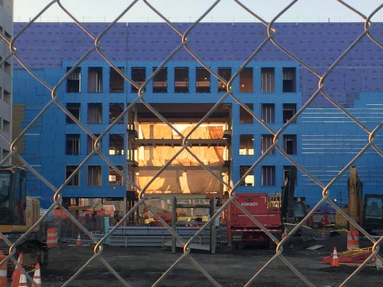 A sunset glows through an opening that will be part of American Water Co.'s headquarters on Camden's Waterfront