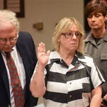 Joyce Mitchell raises her hand during a court appearance with her attorney Stephen Johnston on July 28 in Plattsburgh.