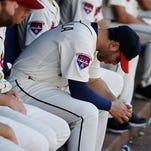 Atlanta's Tommy La Stella hangs his head  in the dugout Sunday during the Braves' loss to the New York Mets. The defeat eliminated Atlanta from playoff contention. a baseball game against the New York Mets, Sunday, Sept. 21, 2014, in Atlanta.
