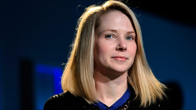 In this Jan. 2013, file photo, Marissa Mayer, CEO of Yahoo, listens during the 43rd Annual Meeting of the World Economic Forum, in Davos, Switzerland. Yahoo reported its quarterly financial results Tuesday.