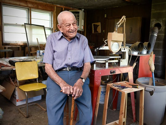 Ken Rudolph, 98, Annandale, laughs in his wood shop where he keeps busy with his scroll saw Thursday, June 2, 2016, on the family farm near Annandale.