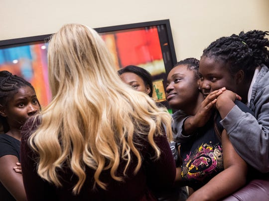 "Marie Volcy, 17, from left, Stephanie Saintyl, 16, and Edlene Francois, 16, listen to Lori Oliver after rehearsal for ""Hairspray"" at the Naples Performing Arts Center on Sunday, Nov. 6, 2016. ""I can think back to a year ago when I first went to Immokalee High School and I was intimidated. I didn't know if they were going to take me seriously,"" Oliver said. ""It took me a little while to earn their trust."""