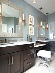 Glass vessels add a touch of color in the master bath,