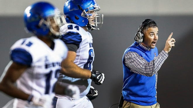 April 22, 2016 - University of Memphis head coach Mike Norvell (right) directs players during the team's Friday Night Stripes spring scrimmage game. (Mark Weber/The Commercial Appeal)