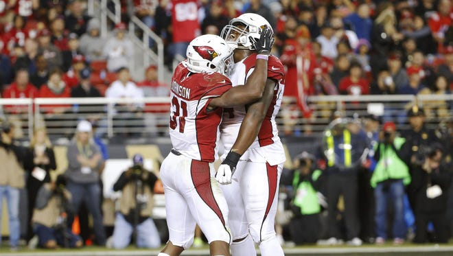 Arizona Cardinals running back David Johnson (31) celebrates his touchdown run with offensive tackle D.J. Humphries (74) against the San Francisco 49ers during the fourth quarter at Levi's Stadium in Santa Clara, Calif.,  Oct. 6, 2016.