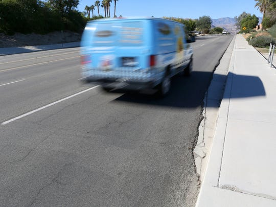 A gutter juts out and takes over the space where the bike lane should be on Fred Waring Dr. near the Indian Wells and Palm Desert border.  This area is in the Whitewater River Storm Channel.
