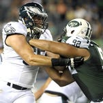 Eagles lineman Lane Johnson, left, will have to serve the rest of his four-game suspension for PED use.
