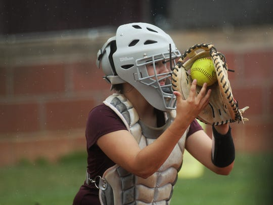 Madison County catcher Amber Reed practices in the