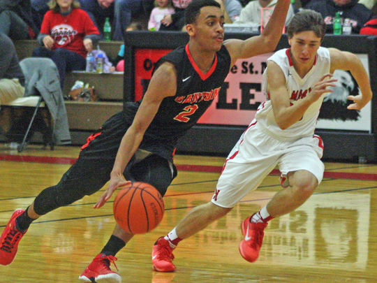 Chris English drives against OLSM's Cooper Abrams.