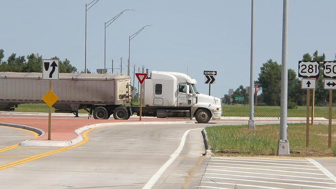 A semi truck moves through a new roundabout, completed May 21, at the intersection of U.S. 50 and U.S. 281 in Stafford County, three miles south of St. John. Photo by Gale Rose]