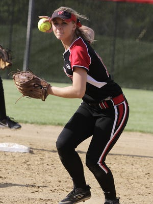 Ashley Cummins of Lakota West comes up firing after scooping the grounder.