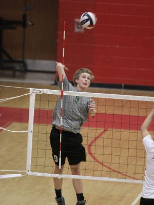 Andy Schmidt of McNick hits from the outside hitter position in 2015.