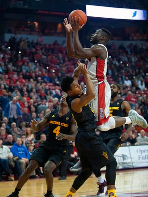 Dec 16, 2015: UNLV Runnin' Rebels guard Ike Nwamu (0) charges into Arizona Sun Devils guard Tra Holder (0) during a game at Thomas & Mack Center.