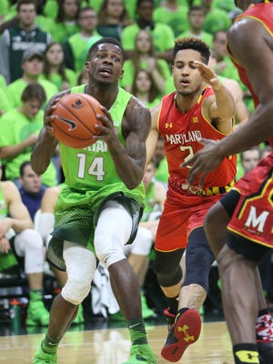 Michigan State Spartans Eron harris drives against the Maryland Terrapins Melo Trimble during second half action on Saturday January 23,2016 at the Breslin Center in East Lansing, MI.