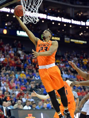 Mar 9, 2017; Kansas City, MO, USA; Oklahoma State forward Leyton Hammonds shoots in the first half against Iowa State during the Big 12 tournament at Sprint Center.
