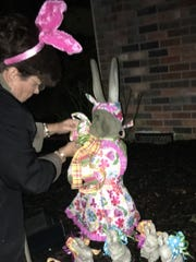 "Henderson resident Sharon Shields caught in the ""act"" of decorating a concrete bunny for Easter."
