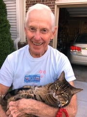 "Dad with my parents beloved cat ""Kitty."""